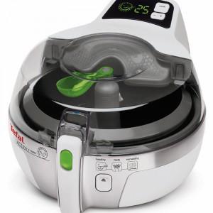Frytkownica Actifry Family AH900039 pozwala na przygotowanie 1,5 kg chrupiących frytek przy użyciu tylko jednej łyżki oleju. Cena: ok. 500 zł, Tefal.