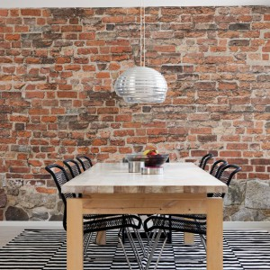 Jeśli kochasz loftowe klimaty, a nie masz tyle szczęścia, by zamieszkać w prawdziwym lofcie, podobną atmosferę zapewni realistyczna fototapeta Old Brick Wall marki Mr Perswall.  1.431 zł (300x265 cm), Tapetomat.