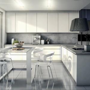 Bazę kuchni Cube stanowią białe, gładkie powierzchnie mebli przełamane stalowymi uchwytami. Lakierowane fronty otwierają się za pomocą wygodnego frezu umieszczanego w jego górnej krawędzi. Wycena indywidualna, BIK Meble.
