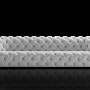 Stylowa pikowana sofa ChesterMoon nawiązująca do tradycyjnych chesterfieldów. Fot. Baxter.