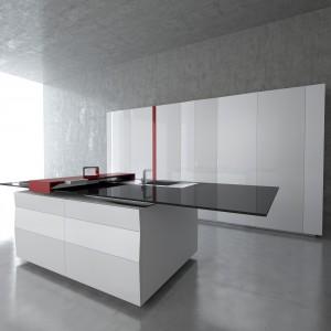 Kuchnia z kolekcji Prisma o minimalistycznym designie. Połączenie dominującej bieli z elementami czerni i czerwieni stworzyło świetne kolorystyczne trio. Każdy z modułów może być konfigurowany według własnych potrzeb. Wycena indywidualna, Toncelli.