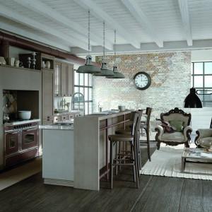 Strefę gościnną, stanowiącą całość z częścią kuchenno-jadalnianą wyznacza jasny dywan. Fot. Zappalorto.