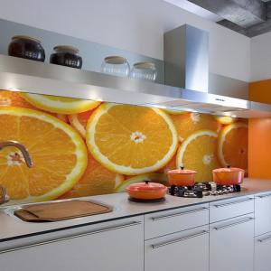 Fototapeta lateksowa Orange ze wzorem apetycznych, smakowitych pomarańczy. Wprowadzi do wnętrza dawkę pozytywnej energii. Pięknie ożywi wnętrze. 85 zł/m², Big Trix.