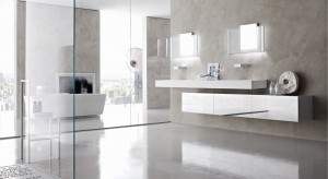 Ozdobne tynki, malowane na szaro fragmenty ścian czy płytki w stonowanym odcieniu – oto idealne tło dla minimalistycznego wystroju wnętrza łazienki.
