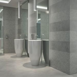 Portland Slim Grey firmy Land Porcelanito to szare płytki w kształcie prostokąta. Powierzchnię okładziny można urozmaicić wykorzystując różne dostępne w serii wykończenia powierzchni, także odwzorowujące cementową fakturę. Fot. Land Porcelanito.