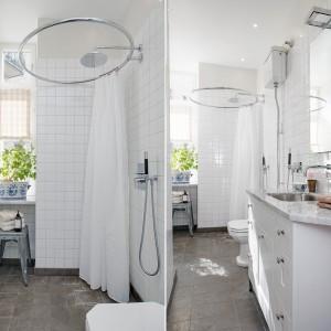 Odnowiona w 2011 roku niewielka łazienka urzeka jasnym wnętrzem. Ściany utrzymano w białej kolorystyce, podłogę wykończono natomiast szarą okładziną z wapienia. Fot. Alvhem Makleri.