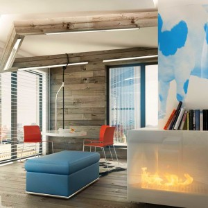 Granice jadalni wyznaczają drewniane belki zamocowane przy suficie. Korespondują one z deskami wyłożonymi na podłodze oraz jednej ze ścian, podkreślając przy tym ciepły, rodzinny charakter nowoczesnego wnętrza. Fot. PressEnter Design.