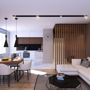 Jadalnię zlokalizowano równoległe do linii podłogi, wyznaczającej granicę pomiędzy salonem i kuchnią. W kuchni powierzchnie wykończono marmurem, w części salonowo-jadalnianej położono drewnianą posadzkę. Projekt: Studio projektowe Geometrium.
