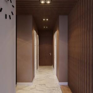 Parawan oddzielający salon od holu przedłużono na powierzchnię sufitu, który w całym holu pokryły drewniane deski. Projekt: Studio projektowe Geometrium.