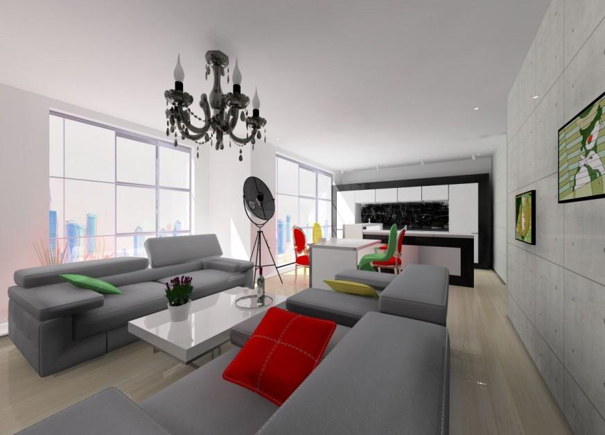 Ogromny metraż salonu połączonego z kuchnią pozwolił na zorganizowanie obszernej przestrzeni wypoczynku, która składa się dużej tapicerowanej sofy i dwóch foteli. Projekt: Wioleta Bednarczyk, pracownia Glamloft. Fot. Wioleta Bednarczyk.