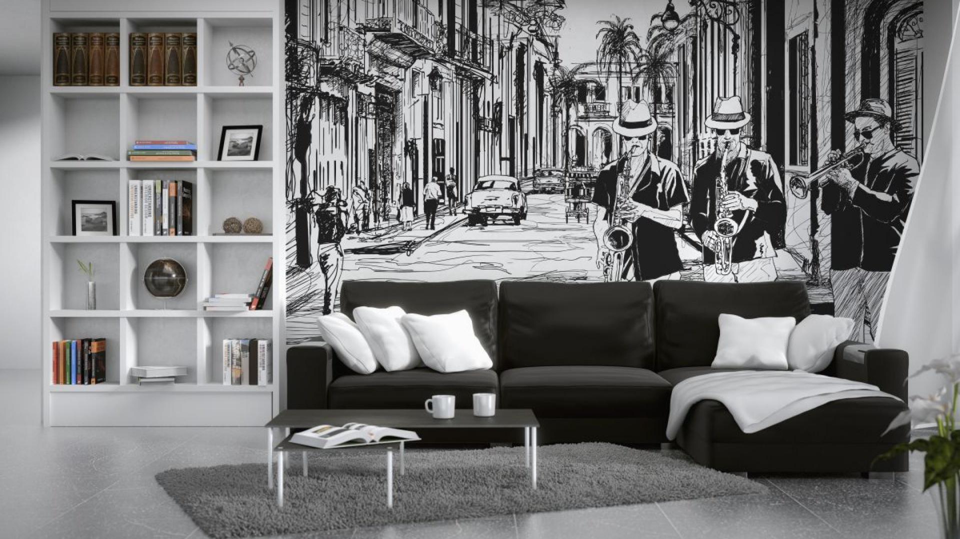 Czarno-biały komiksowy rysunek świetnie pasuje na ścianę za narożnikiem w salonie. Ekologiczna tapeta papierowa pokryta w pełni bezpiecznym dla zdrowia drukiem lateksowym dostępna jest w sklepie Minka. Fot. Minka.