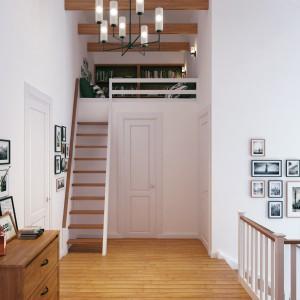 Drugie piętro połączono z niewielką antresolą niewielkimi schodami. W prywatnym kąciku można zrelaksować się przy książce. Białe ściany w holu zdobią liczne obrazki, a całość utrzymana jest w skandynawskim stylu. Projekt i wizualizacje: Studio projektowe Geometrium.