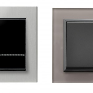 Kolekcja Sonata firmy Ospel pozwala zamienić osprzęt elektryczny w prawdziwe dzieło sztuki, stanowiące efektowną dekorację wnętrza, jak te łączniki z aluminium i szarego szkła. Fot. Ospel.
