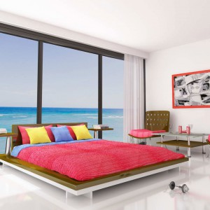 Różowa narzuta na łóżko, uzupełniona o kontrastujące poduszki spektakularnie odmieni wygląd sypialni. Efekt wzmocni pomalowanie ramy obrazu. Fot. Bo Concept.