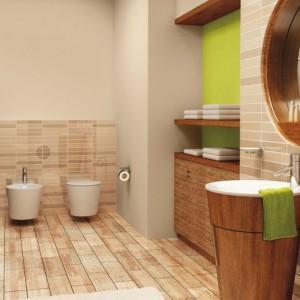 W miejscach szczególnie narażonych na wilgoć zastosowano płytki, pozostałą część ścian w łazience pomalowano dwoma odcieniami farby. Delikatny, jasny kolor połączono z intensywną zielenią. Na zdjęciu: ściany pomalowana farbami marki Śnieżka. Fot. Śnieżka.