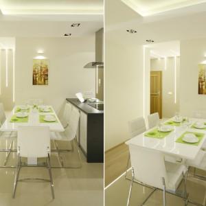 Wzdłuż półwyspu ustawiono biały stół jadalniany, któremu towarzyszą równie białe krzesła na lekkich metalowych nogach. Projekt: Marta Kilan. Fot. Bartosz Jarosz.