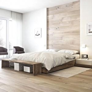 Macie dosyć monotonnej ściany? Wykończcie jej fragment drewnem, np. deską barlinecka w kolorze dąb gentle. Ułożona po szerokości łóżka pełni rolę efektownego zagłówka, sięgającego aż po sam sufit. Fot. Barlinek.