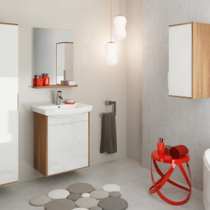 Meble łazienkowe z serii Bamako firmy Cersanit to modne połączenie drewna z białą płytą na wysoki połysk. Dekor w kolorze ciemnego jesionu ociepla aranżację utrzymaną w stonowanej, szarej kolorystyce. Fot. Cersanit.