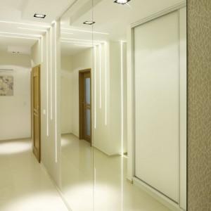 W eleganckim apartamencie przedpokój jest wizytówką domu. Urządzony w jasnych, stonowanych barwach prezentuje się niezwykle wytwornie. Projekt: Marta Kilan. Fot. Bartosz Jarosz.