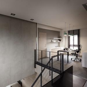 Szare ściany z efektem betonu kontrastują z powierzchniami wykończonymi naturalnym drewnem w ciepłym, przytulnym kolorze. Projekt: Circle Huang&Gina Chiu. Fot. Hey! Cheese.