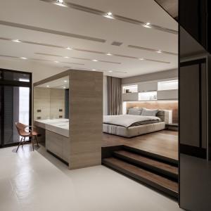 Sypialnię częściowo zamyka niewielka ścianka działowa. Po jej drugiej stronie urządzono toaletkę, wyposażoną w umywalkę i duże lustra. Projekt: Circle Huang&Gina Chiu. Fot. Hey! Cheese.