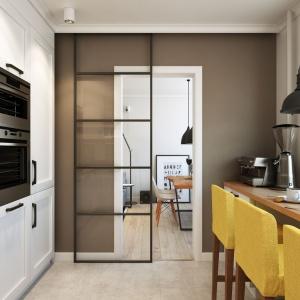 Oryginalnym zastąpieniem klasycznych drzwi prowadzących do kuchni są te przesuwane, oszklone, jedyne w swoim rodzaju. Projekt i wizualizacje: Alexei Ivanov i Pavel Gerasimov / Studio projektowe Geometrium.
