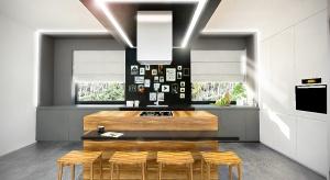 Zobacz propozycję aranżacjikuchni z wyspą w stylu nowoczesnym, w połączeniu z elementami drewnianymi.