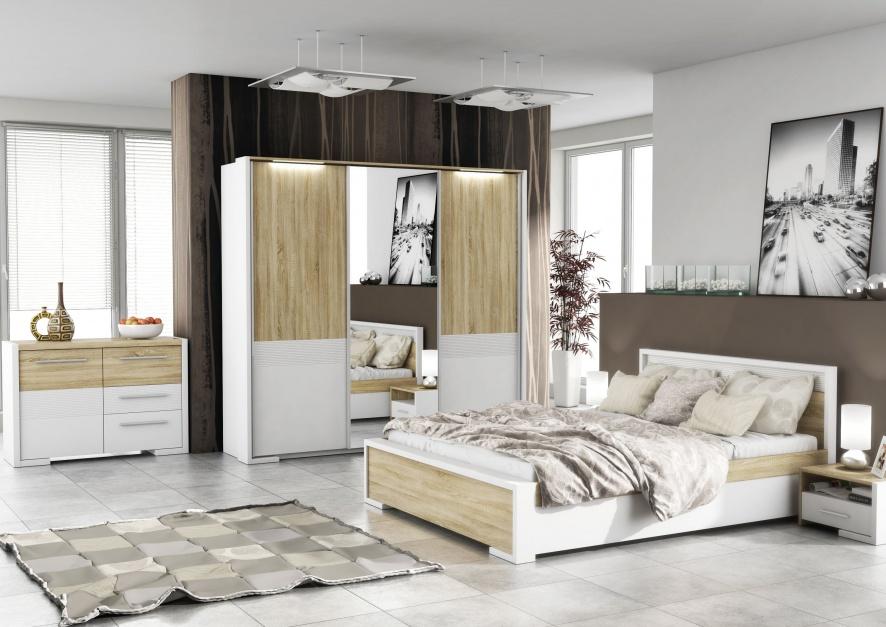 Sypialnia Home Media to harmonijne bryły mebli, które łączą w sobie biel i jasny odcień drewna. Wprowadzą do sypialni naturalny klimat, ale też przytulny. Fot. FM Bravo.