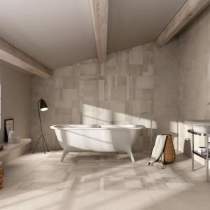 Minimalistyczna łazienka pod skosami, mimo szarych ścian i podłogi wydaje się bardzo przytulna. Wizualnie ocieplają ją drewniane elementy dekoracyjne. Na zdjęciu: seria Carnaby marki Supergres. Fot. Supergres.