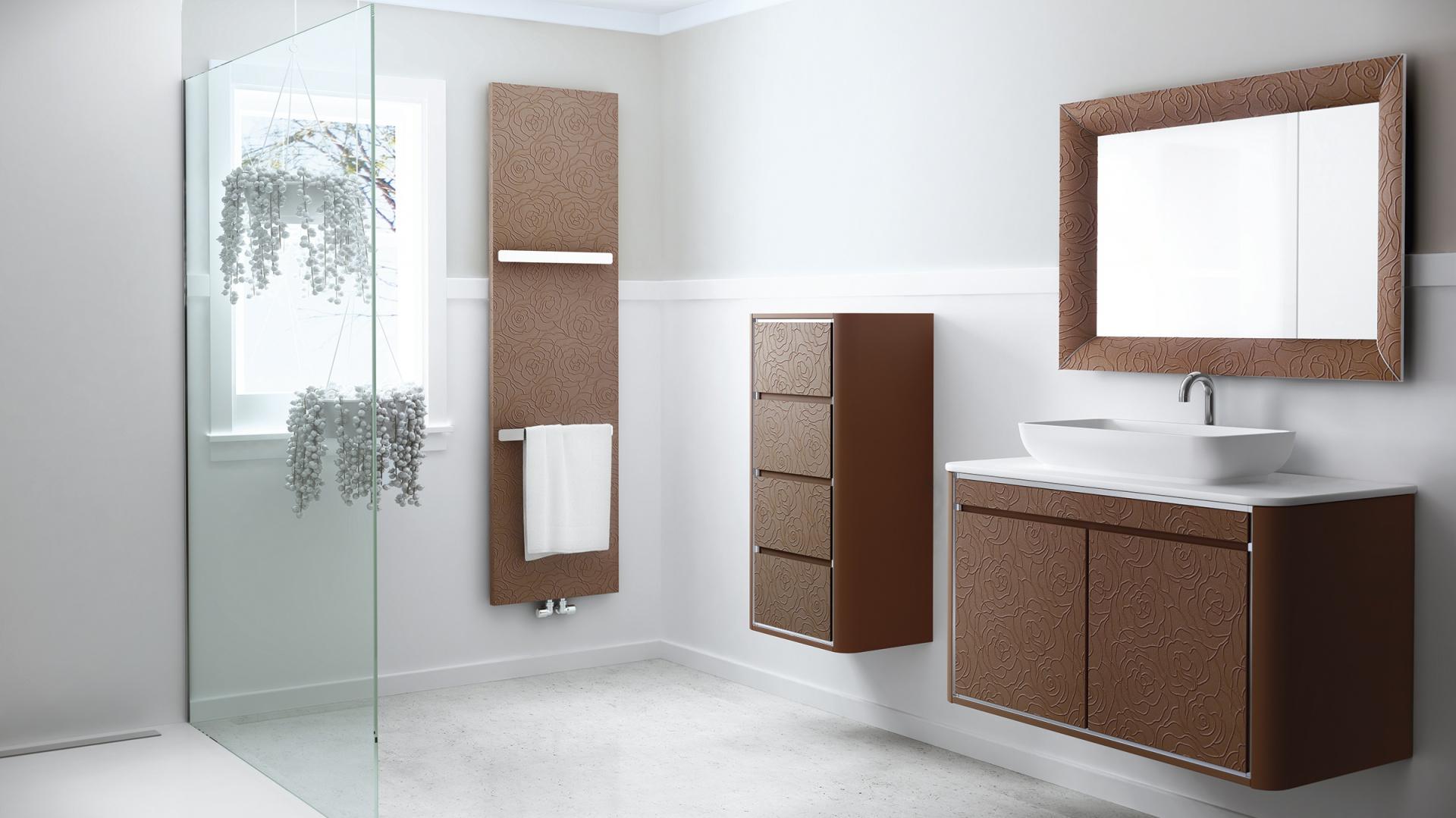 Z tego samego materiału można zamówić i meble łazienkowe, i grzejnik – seria In Touch firmy Fiora. Fot. Fiora.