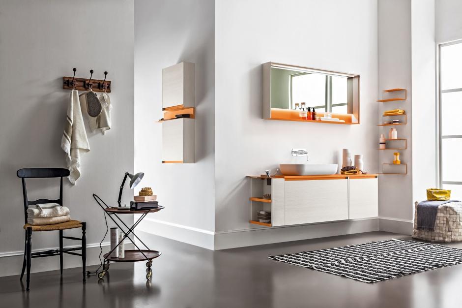 Biel z pomarańczowymi akcentami - meble łazienkowe Zero firmy Arblu. Fot. Arblu.