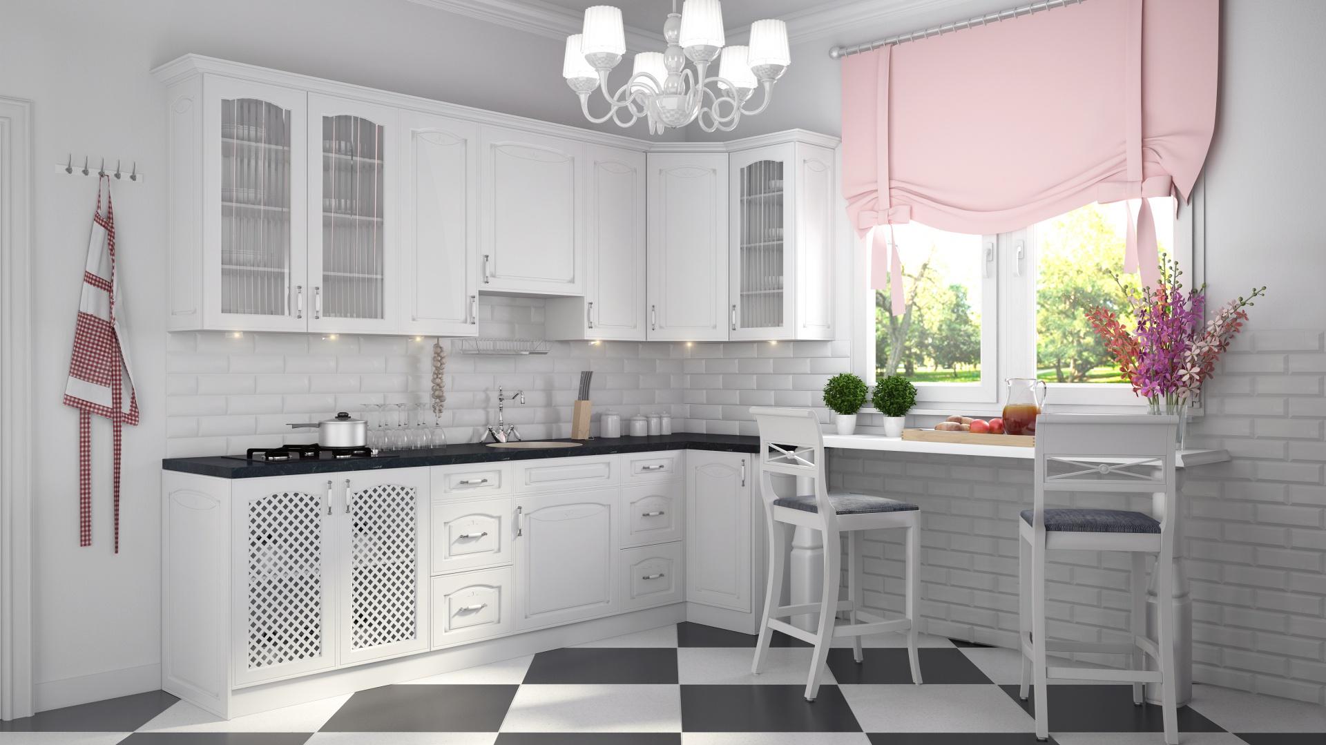 Białe fronty szafek z charakterystycznym frezowaniem, zdobne wieńce górne oraz ażurowe elementy sprawiają, że kuchnia Amelia Biała Patyna prezentuje się nad wyraz elegancko. Fot. Stolkar.