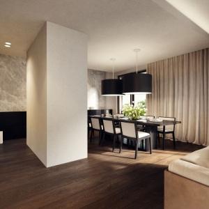 Z salonem sąsiaduje duża jadalnia, idealna do urządzania domowych biesiad. Przy eleganckim, drewnianym stole zmieści się nawet 10 osób. Projekt: Tamizoo Architects. Fot. Echo Investment.