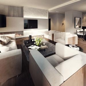 Sercem apartamentu jest otwarta strefa dzienna, w obrębie której urządzono salon i dużą jadalnię. Projekt: Tamizoo Architects. Fot. Echo Investment.