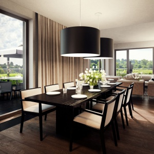 Wnętrze urządzone w stonowanych kolorach ziemi rozświetla naturalne światło dzienne wpadające do środka przez okazałe, panoramiczne przeszklenia. Projekt: Tamizoo Architects. Fot. Echo Investment.