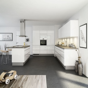 Biała kuchnia, zwieńczona laminowanym blatem w szarobeżowym kolorze zyskała na lekkości dzięki wykończeniu frontów kuchennych na wysoki połysk. Fot. Nettoline.