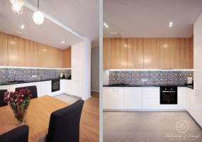 W kuchni wykorzystany został kolor biały, czarny w połączeniu z naturalnym odcieniem dębu i kolorowymi płytkami.