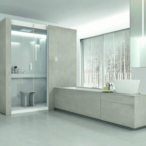 Śnieżna biel i cementowe powierzchnie – tutaj wykorzystano Eco-cement firmy Makro Bathrooms Concepts. Fot. Makro Bathrooms Concepts.