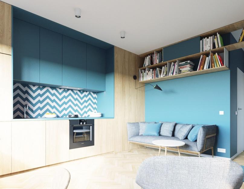 Jedność przestrzeni całego mieszkania podkreśla drewniana podłoga w jodełkę oraz zastosowana na wszystkich ścianach (i niektórych frontach mebli) niebieska kolorystyka. Projekt i wizualizacje: 081 Architekci.
