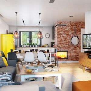 Zabudowa kominka z czerwonej cegły stylizowanej na stary mur w połączeniu z nowoczesną, kolorową lodówką komponuje się nieszablonowo, aczkolwiek bardzo ciekawie. Na wizualizacji wnętrza Domu w zielistkach 5 Archon+ znajdują się: stół Denver, krzesła Norden Cross, lampy Matrix, stolik Maxime, kominek MBZ, narożnik Biki, dostępne w sklepie archonhome.pl