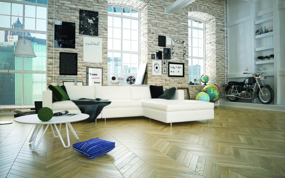 Dwuwarstwowa deska dębowa w pięknym, surowym wybarwieniu Dąb Alabastro idealnie wpisuje się w loftową aranżację tego salonu. Fot. Jawor Parkiet.