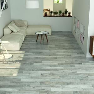 Producenci płytek ceramicznych oferują produkty do złudzenia imitujące drewniane deski, które idealnie sprawdzą się w aranżacji salonu. Fot. Bellacasa, gres z kolekcji Forest.