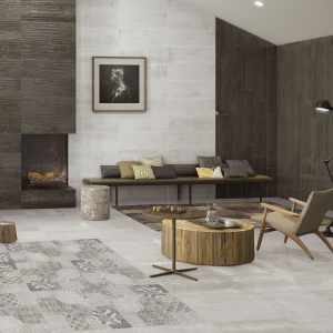 Patchworkowy wzór w tonacjach szarości i brązów stanowi eleganckie urozmaicenie aranżacji wnętrza tego salonu. Fot. Azteca, seria Navy Lux