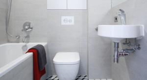 Łazienka dla gości to pomieszczenie skąpane w stonowanych szarościach. Inwestorzy chcieli, by panował w niej chłodny, industrialny styl.
