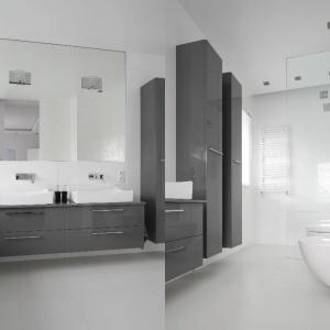Nowoczesna łazienka: szare lakierowane meble prezentują się efektownie na tle białych okładzin. Projekt: Katarzyna Mikulska-Sękalska. Fot. Bartosz Jarosz