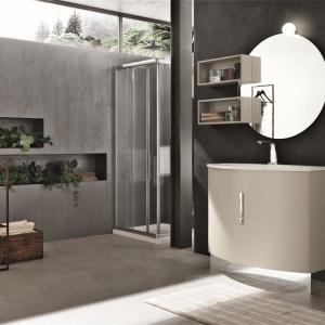 W loftowej aranżacji łazienki świetnie prezentuje się proste okrągłe lustro, połączone z dwiema otwartymi półkami. Fot. Artesi, kolekcja Rock