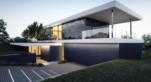 Dom Pawilon to przykład wykorzystania zróżnicowanego ukształtowania terenu między kondygnacjami budynku, aby uzyskać nowoczesny i atrakcyjny efekt. Wyróżnia się stonowaną biało-szarą elewacją oraz geometrycznymi bryłami. Dodatkowo w projekci