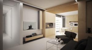 Biel, drewno i szarości zamknięte w nowoczesne, geometryczne formy. Zobaczcie projekt nowoczesnego mieszkania autorstwa polskiej pracowni.