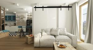 Projekt wnętrza warszawskiego mieszkania zaaranżowano w jasnych barwach, wykorzystując do tego przeszklenia w ścianach oraz przesuwne drzwi do niewielkiej sypialni. Całość wnętrz została zaprojektowana w duchu tradycji, bez zbędnych ekstrawaganc
