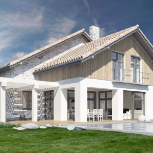 Szklane elementy elewacji budynku nadają jego bryle wyjątkowy charakter. Proj. N8, Fot. S&O Projekty Sylwii Strzeleckiej